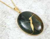 Kintsugi (kintsukuroi) fancy jasper oval stone cabochon pendant with gold repair in gold setting on curb chain - OOAK