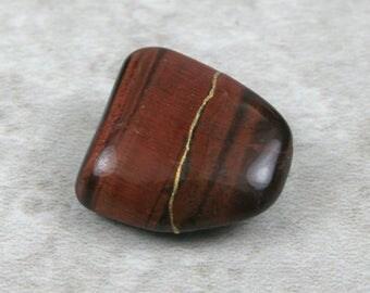 Kintsugi (kintsukuroi) inspired red tigereye tumbled stone - OOAK