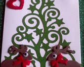Christmas tree with cute reindeers and a touch of sparkle