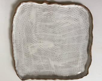 organic square platter on dark stoneware