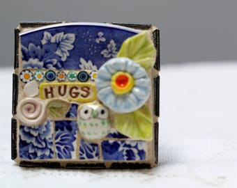 HUGS mixed media, one of a kind mosaic art.