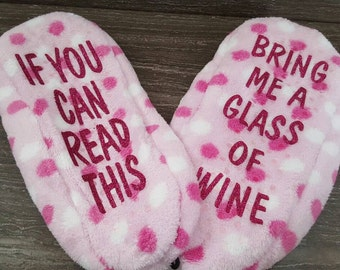 Pink and white polka dotted  slippers that say If you can read this bring me a glass of wine. Size XL. Size 11 slippers. Wine slippers.