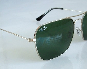 Sunglasses RayBan Caravan RB3136 55mm Small size for men medium for women original Silver frame Green lens Mint never worn 100% Authentic.