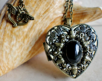 Agate music box locket, heart shaped locket with music box inside, in bronze with a  black and clear agate stone cabochon in center.