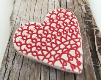 Handmade ceramic textured heart brooch in red