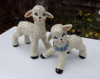 Sweet pair of vintage ceramic lambs for Easter;  white with black tails and hooves - one with blue floral garland - perfect