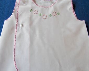 Embridered new born baby girl top.  Baby shower gift