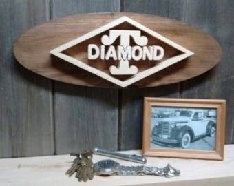 Diamond T truck Emblem Oval Wall Plaque-Unique scroll saw automotive art created from wood.