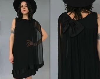 1960s black crepe rayon wiggle cape dress