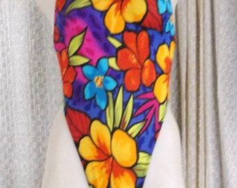 Floral print bodysuit with rio rear and fits medium and some smalls