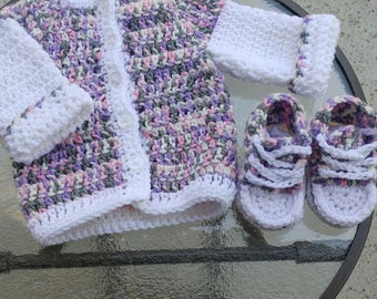 Crocheted baby sweater and booties