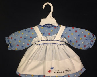 Dress and Apron for 25 inch Raggedy Ann Doll; blue dress with red, white, blue, and yellow stars, embroidered Apron
