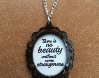 Laser cut acrylic gothic framed 'There is no beauty without some strangeness' pendant