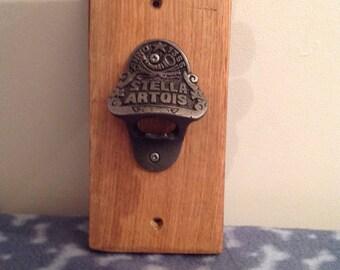 Stella Artois bottle opener on oak back