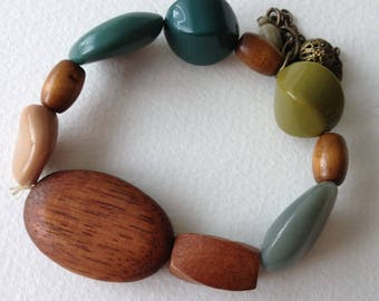 Green blue plastic and wood beaded bracelet