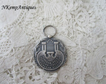 Old music pendant/medal