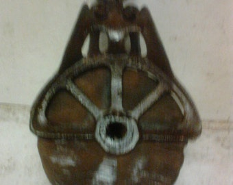 Wood and metal pulley