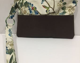 Summer clutches are here.  Faux leather bottom This clutch is a must have this summer. Buy yours now before they are gone.