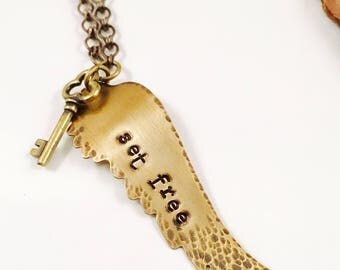 Set Free brass wing necklace
