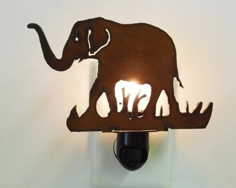 Elephant night light made out of rusted metal