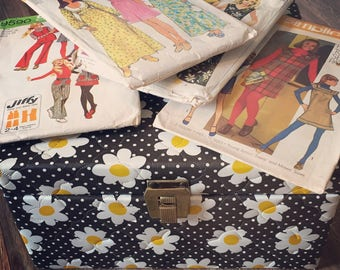 Fun 1960's flower power print sewing box with 4 retro patterns, perfect for gift giving.