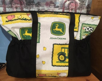 John Deere diaper bag. Can make different prints and colored pockets. Name added for free