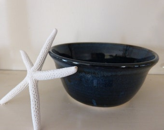 Small dark blue bowl.