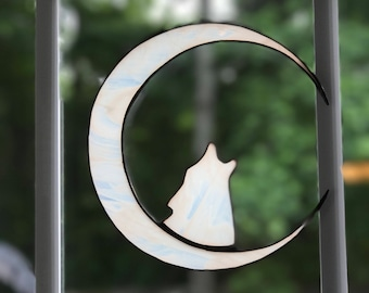 Wolf howling in a crescent moon