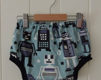 Geek alert! Nappy pants featuring a super cool robot print. Perfect for little boys or girls (size 00, suits 6 - 12 months).