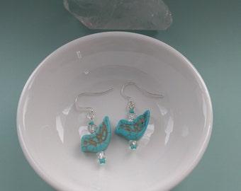 Turquoise bird earrings.