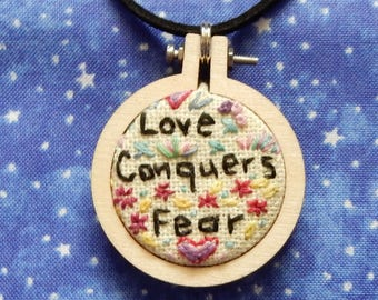 Embroidered Necklace; signs from the women's march