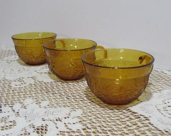 Sandwich Glass Tea or Coffee Cups ~ Group of 3 ~ Anchor Hocking ~ Desert Gold Color ~ Amber Sandwich Glass ~1960's~Scroll and Flower Pattern