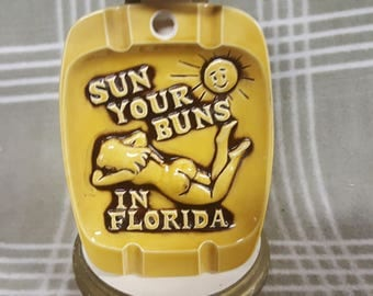 "Vintage Risque ""Sun Your Buns in Florida"" Ashtray.  Nude Sunbathing Woman.  Smiling Sun. Retro. CNI Japan."