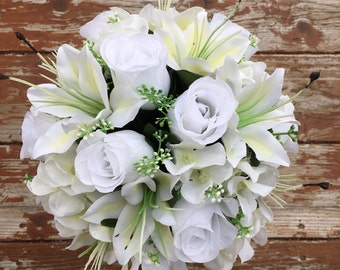 White rose, lily, and hydrangea bouquet & bout