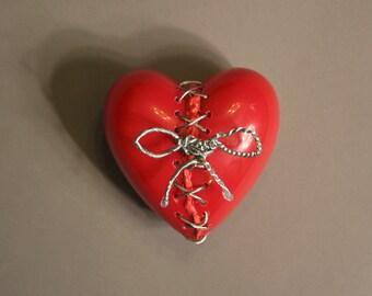 Mended heart sculpture