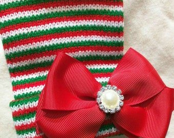 Newborn CHRISTMAS HOLIDAY hospital hat with a Beautiful red ribbon and topped off with a Pearl and Rhinestones! CUTE! The Joy