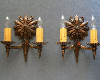 Antique pair of bronze Art Deco sconces