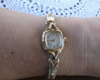 Vintage Art Deco Style Swiss Ladies Wrist Watch by Caravelle, Wind up Watch Works Great!  Fits Medium to even larger wrists, Stretch Band
