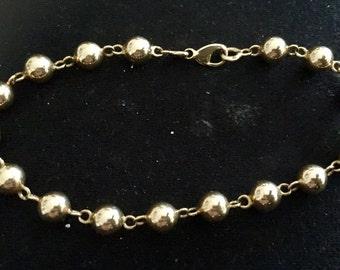 Bracelet balls OM gold 18 carats yellow gold 750/000, Eagle head, full balls punch