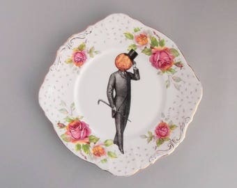 Victorian man with old penny head; quirky wall art; upcycled vintage floral Paragon bone china cake plate