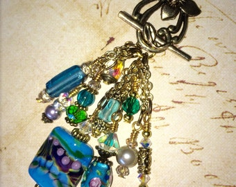 Beaded charm dangle necklace.