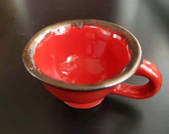 Red and gold pinch pot ceramic tea cups