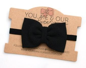 Black Bow Headband; Black fabric bow on a black elastic headband; baby, toddler, or girl's headband