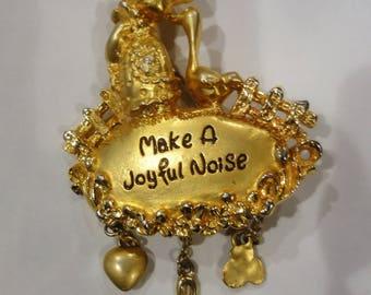 "Gold Tone Brooch "" Make a Joyful Noise"" Marked PMI"