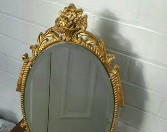 Beautiful vintage Atsonea desk mirror vanity piece in gold gilded wooden frame with stand at the back