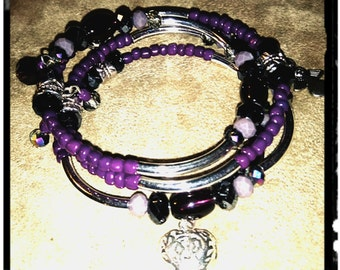 Memory wire bracelet. Purple tones