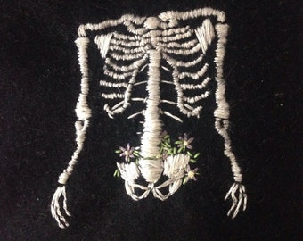 Flowering skeleton torso hand embroidered patch