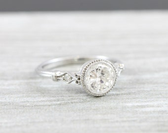 Diamond engagement solitaire ring bezel rubover set in 18 carat white gold handmade art deco inspired 1 carat
