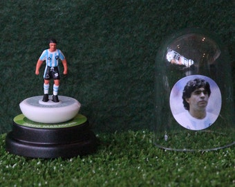 Diego Maradona (Argentina) - Hand-painted Subbuteo figure housed in plastic dome.