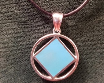 ssj06- NA Silver Service Symbol Pendant .925 Sterling Silver With Blue Enamel
